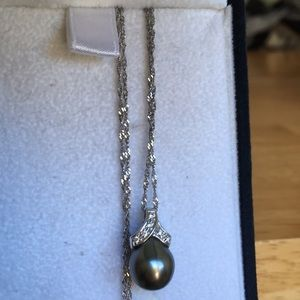 Black pearl 14k gold necklace.